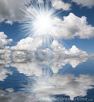 Sun,blue sea and white clouds reflection