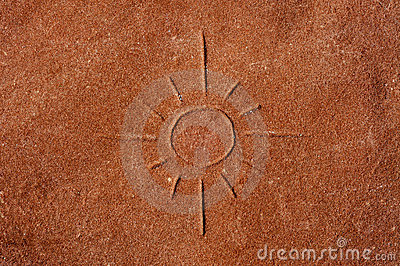 A sun carved on a stone