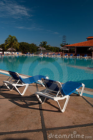 Free Sun Chairs By The Pool Stock Image - 17762591