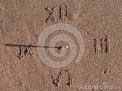 Sun clock on sand