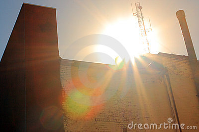 Sun Coming Up Over Brick Building