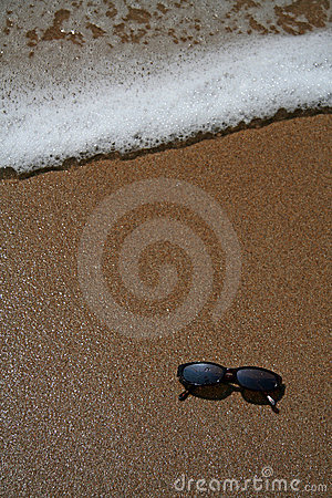 Free Sun Glasses In The Sand At The Beach Royalty Free Stock Photos - 792908