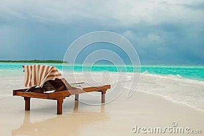 Sun lounger on tropical beach