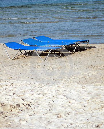 Sun loungers or beds on sandy beach