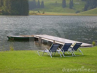 Sun loungers by lake