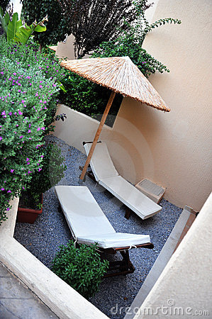 Sun loungers on small patio