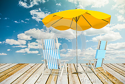 Sun loungers and umbrella