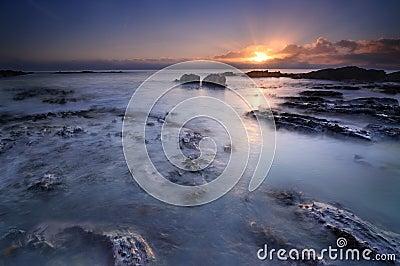 The sun meeting the ocean
