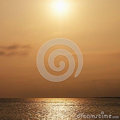 Sun over ocean.