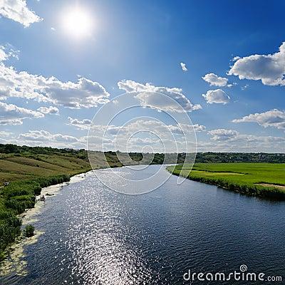 Sun over river