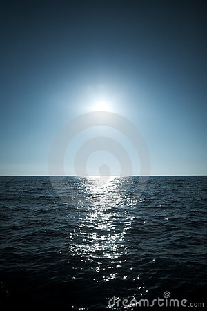 Sun over the sea horizon