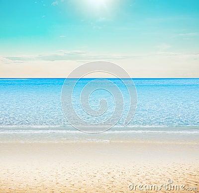 Sun over tropical beach