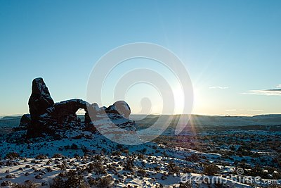 Sun over Turret Arch in Arches National Park