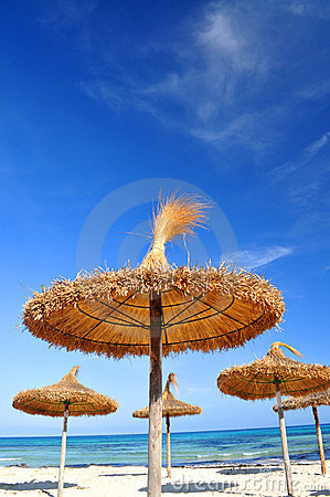 Sun parasols on a idyllic beach