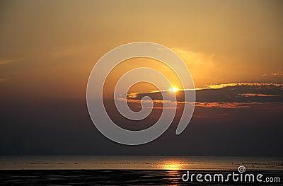 Sun partially covered by cloud at Busaiteen beach