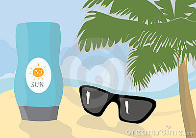 Sun protection cream and sunglasses on a beach