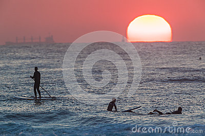 Sun Horizon SUP Riders Surfing Editorial Photo