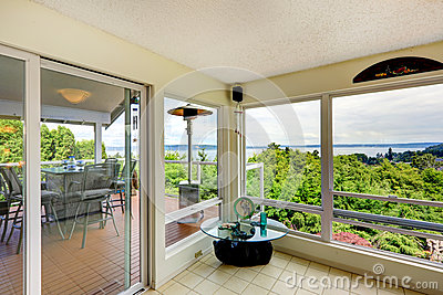 Sun room interior with door to walkout deck