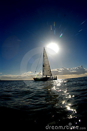 The sun and a sailboat