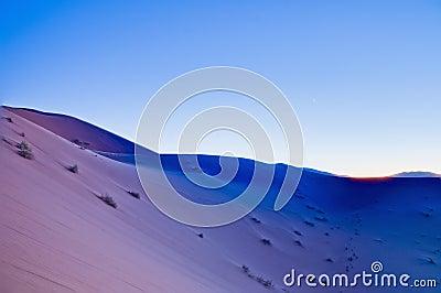 Sun sets over Erg Chebbi at Morocco