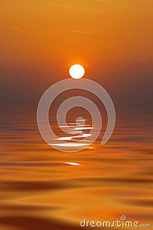 Sun setting in calm ocean