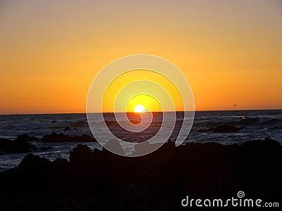 Sun setting over Asilomar State Beach