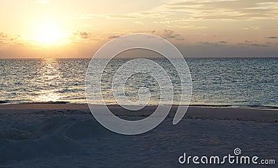 Sun Setting Over Beautiful Deserted Beach