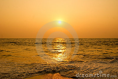 Sun setting in a sea beach.