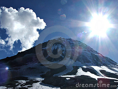Sun shining, snow mountain and clouds