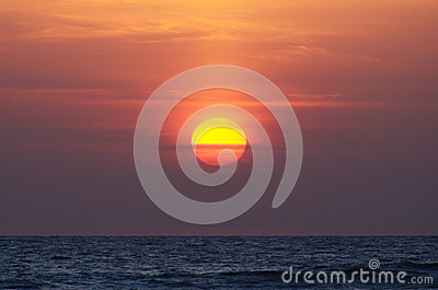 Sun in the sky over the ocean, sunset