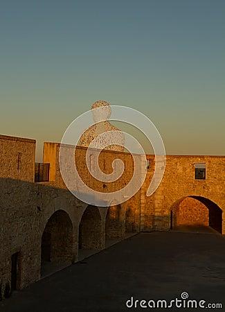 Sun in the stone wall