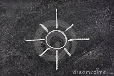 Sun, sunshine, and light symbol on blackboard