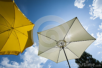 Sun umbrella at wonderful summer day with blue sky