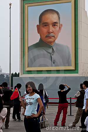 Sun-Yat Sen portrait and Chinese enthusiastic girl Editorial Photo