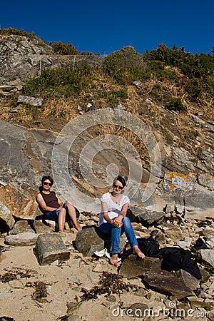 Sunbath on the rocky beach