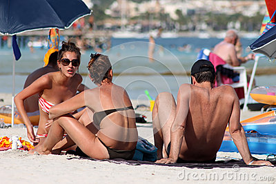 Sunbathers on Spanish beach Editorial Photography