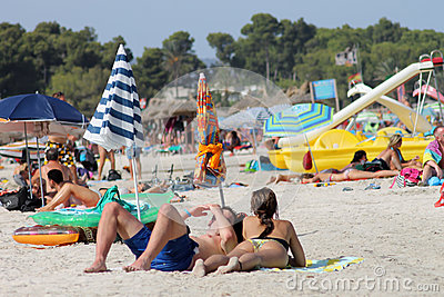Sunbathers on Spanish beach Editorial Image