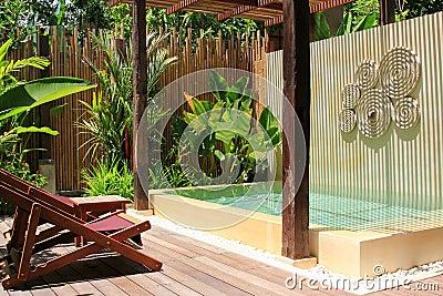 Sunbathing chairs along the swimming pool