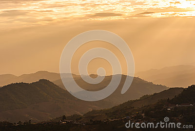 Sunbeam on mountain landscape and misty