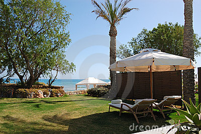 Sunbeds at the beach of luxury villa