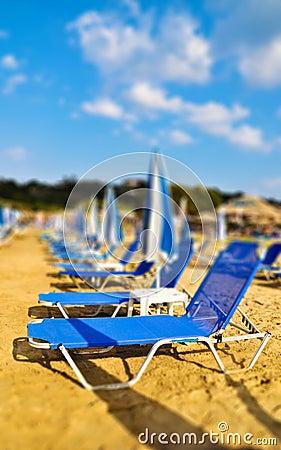 Sunbeds on the beach. Tilt shift photo
