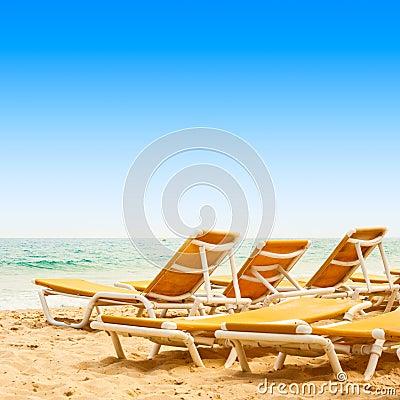Sunbeds on the sandy beach