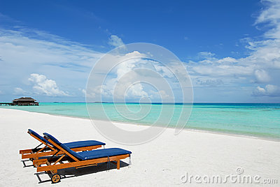 Sunbeds on tropical beach