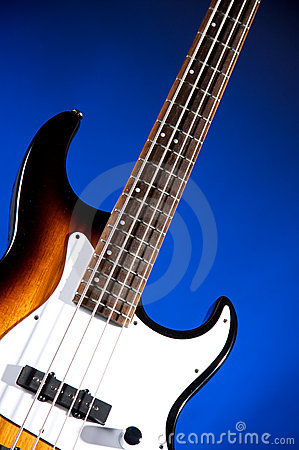 Sunburst Bass Guitar Isolated On Blue