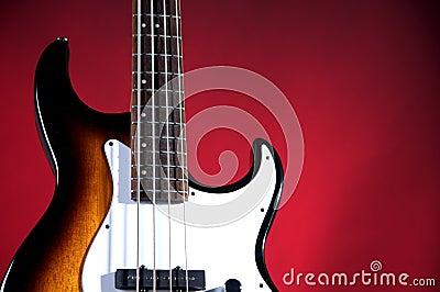 Sunburst Bass Guitar Isolated On Red