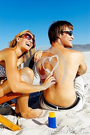 Suncare beach couple