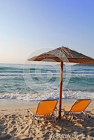 Sunchair and umbrella on Greek beach