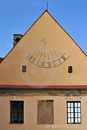 Sundial on the wall old building