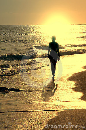 Sundown on sea and girl