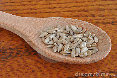 Sunflower Seeds on Wooden Spoon